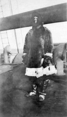 "[Captain Foellmer dressed in a parka and mukluks on board the ""Baymaude""]"