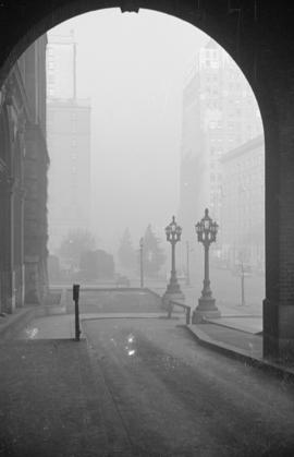 [View along Georgia Street through the arch of the entrance of the second Hotel Vancouver]