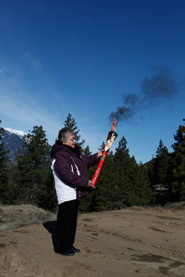 Woman holding torch in Lytton, BC [2 of 3]