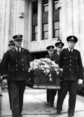 Fireman carrying Gerald McGeer's coffin, leaving City Hall