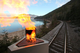Day 90 The Olympic Flame enjoys a spectacular view aboard a Canadian Pacific Train in British Col...
