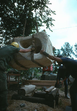 Joan Gambioli's sculpture being hoisted