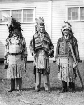 W. Leek and unidentified men wearing First Nations clothing
