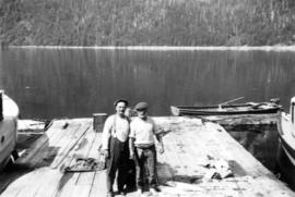 [Two men on dock with salmon catch, Stuart Island, B.C.]