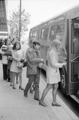 Boarding a bus at Hudson's Bay Company on W. Georgia Street