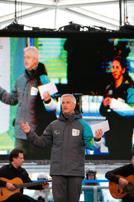 Torch Relay crew member on stage