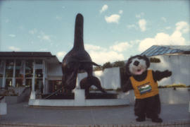 Tillicum beside Bill Reid orca sculpture at the Vancouver Aquarium