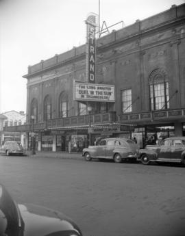 "[Exterior view of the Strand Theatre showing advertising for the movie ""Duel in the Sun""]"
