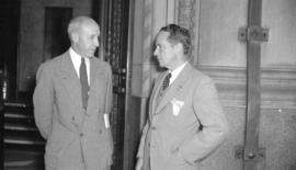 [Stanley Burke of Boeing Aircraft, Ltd. talking with Ralph P. Bell, Dis. Gem. of Aviation]