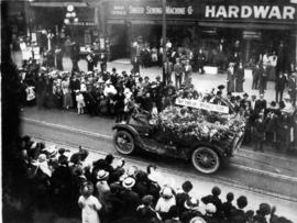 [The Tait Tire Company float in the 600 Block of Granville Street during a Victoria Day parade]