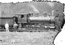 [Two men standing in front of C.P.R. engine number 314 at Field, B.C.]