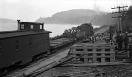 Vancouver East [materials and train at storage tank site]