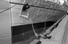 "[The bow of the ""Empress of Japan"" at dock]"