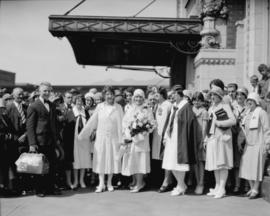 Arrival at Great Northern Railway depot of Aimee Semple McPherson on visit to Foursquare Gospel T...