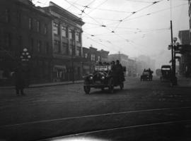 [Men in taxicabs on Granville Street at Davie Street]