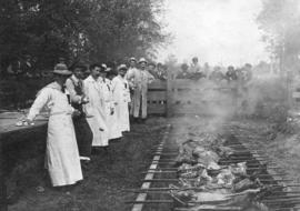 [Cooking meat at a W.A. McIntosh's butchershop employees picnic]