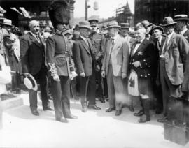 Lieutenant R.G. Evans, director of the H.M. Coldstream Guards band, and dignitaries in front of c...