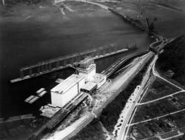 Aerial view of Alberta Wheat Pool elevator under construction and original Second Narrows Bridge