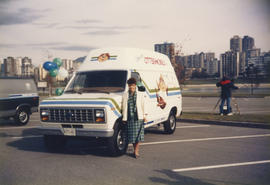 Centennial Commissioner standing beside the Ottermobile