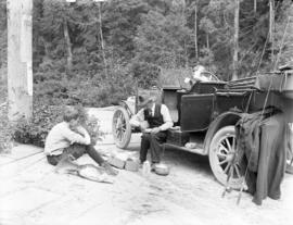 [Cowdell and kids having picnic at side of road during fishing trip]