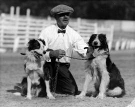 Man kneeling with two dogs