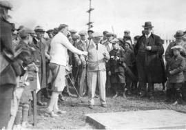 [Mayor L.D. Taylor and other spectators at golf tournament]