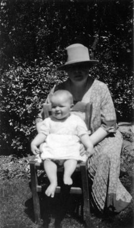 [Octavia Beaton sitting outdoors with Mary Louise Taylor]