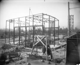[Men constructing steel frame of Horne Payne substation]