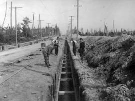 [Looking east from Elm Street along Wilson Road (41st Avenue) at sewer construction]