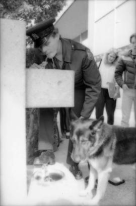 Constable Rob Bosley and police dog Sport at drinking fountain