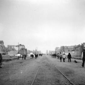 [View of street in New Westminster taken from a Westminster and Vancouver Tram Company caboose af...