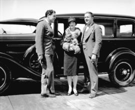 John Bowers and Marguerite De La Motte [and unidentified man] pose with car