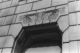 [Carving above Marine building window]