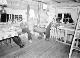[Three men in Enquist Lodge, Mt. Seymour, B.C.