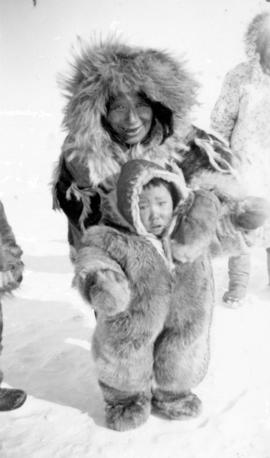 [Eskimo grandmother and child wearing fur clothing]