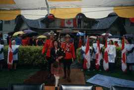 Bagpipe player and Mounties leaving Brockton Point Clubhouse at the Centennial Commission's Canad...