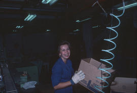 Female worker with box