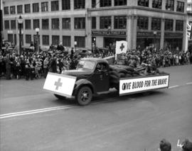 Give blood for the brave sign on truck, World War II parade on Burrard Street