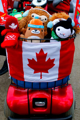 Day 91 A scooter basket full of Olympic mascots brought out to celebrate the flame in British Col...