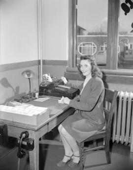 [B.C. Telephone employee at her desk]