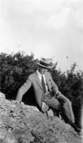 [L.D. Taylor sitting on rocky hill]