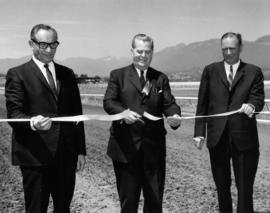 J. Diamond, Premier W.A.C. Bennett, and W.A. Randall at ribbon cutting ceremony