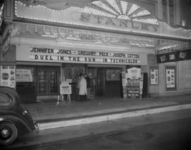 [Exterior of the Stanley Theatre showing a close-up view of the front entrance and marquee with a...