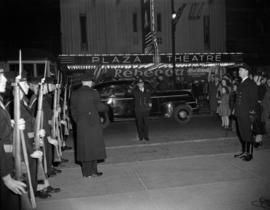 "[Navy officers saluting while walking to the entrance of the Orpheum for the opening of ""Mee..."