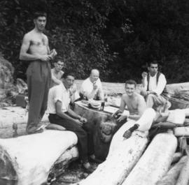 Group of men drinking beer at the beach