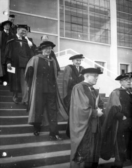 University of British Columbia dignitaries leaving the War Memorial Gymnasium