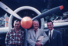 Kendan McCuaig and two men in front of plane propeller