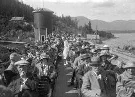 Pacific Great Eastern Railway - first trip to Alta Lake [travellers on open railway car]