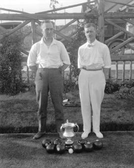 [Portrait of two men with a trophy at] Vancouver Lawn Bowling Club