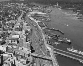 Aerial view of northwest corner of downtown core, showing Marine Building, waterfront industries ...